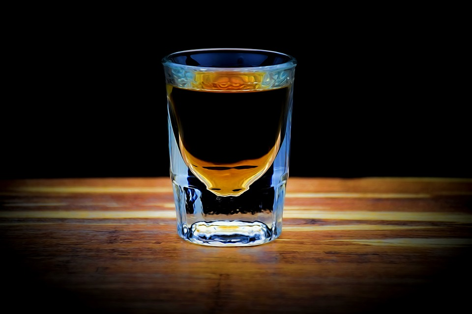 How many calories are in a shot of whiskey - whiskey shot on a table